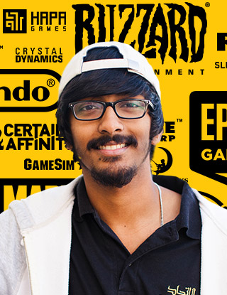 Male indian student standing infront of video game logos