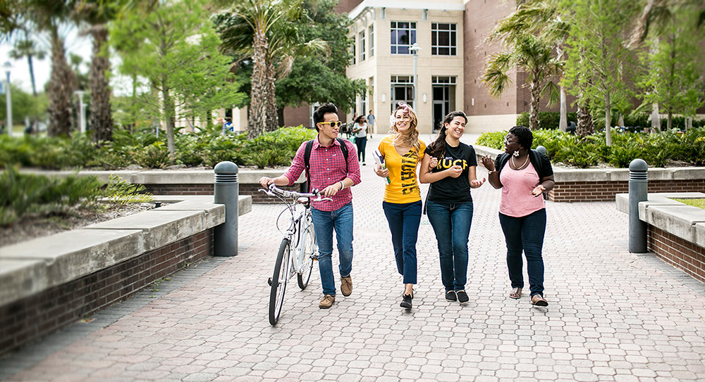 Diverse group of UCF students walking to class