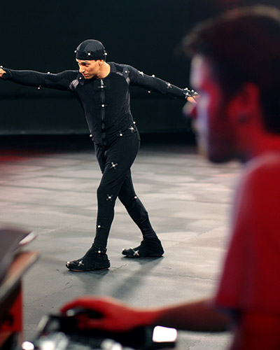 Young latin male wearing a motion capture suit in a pose