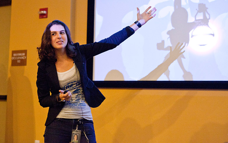 Female student giving presentation and pointing to the screen